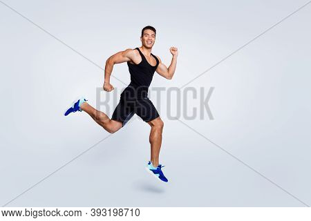 Full Length Body Size View Of Nice Attractive Strong Sportive Muscular Cheerful Cheery Proud Guy Jum