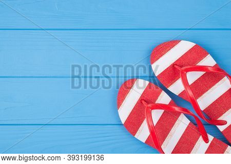 Vacation Time Concept. Top Above Overhead View Photo Of Striped Flipflops Isolated On Blue Wooden Ba