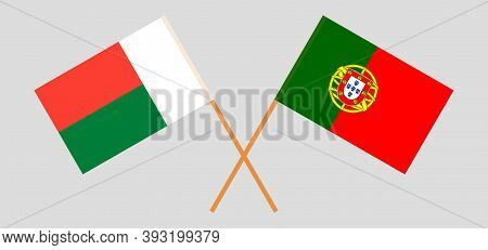 Crossed Flags Of Madagascar And Portugal. Official Colors. Correct Proportion. Vector Illustration