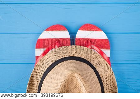 Summertime Vacation Concept. Top Above Overhead View Close-up Photo Of A Pair Of Flipflops And A Hat
