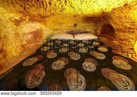 Coober Pedy, South Australia, Australia - Aug 28, 2019:underground Bed Of An Underground House Carve