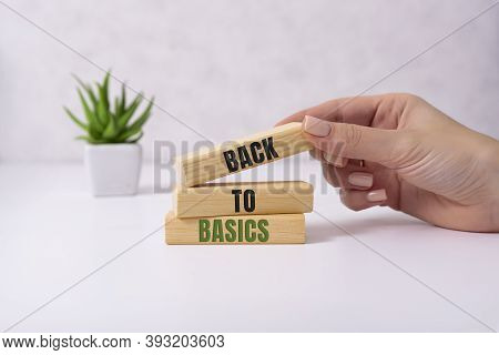 The Words Back To Basics Made Of Letters On Wooden Blocks. Back To Basics - Fundamental Principles C