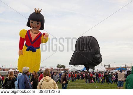 Albuquerque,  New Mexico / Usa - October 8, 2014:  A Princess Shaped Balloon And A Darth Vader Helme