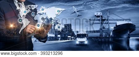 Multiple Exposures Of Businessman Touching Tablet For Analyze Stock At Logistics Port And World Map