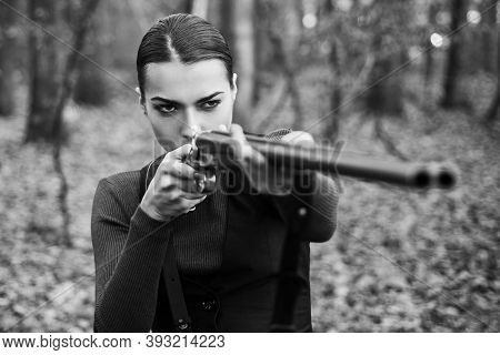 Hunter Woman With Shotgun On Hunt. Hunting In Forest. Portrait Of Woman Hunter. Closed And Open Hunt