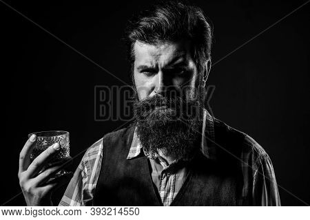 Sommelier Tastes Expensive Alcohol Drink. Confident Well-dressed Man With Glass Of Whisky
