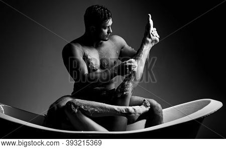 Loving Couple In A Bathroom On A Black Background. Sexy Woman. Handsome Sensual Sexy Young Man With