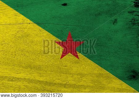 Flag Of French Guiana On Wooden Plate Background. Grunge French Guiana Flag Texture, The Green And Y