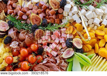 Table With Variety Or Assortment Of Cheese, Fruits And Deli. Close Up.