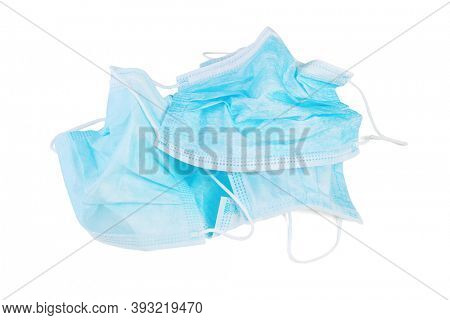 Discarded Used Face Masks on White Background