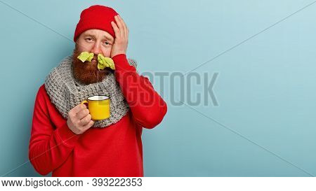 People, Illness And Treatment Concept. Dissatisfied Bearded Man Stucks Noses With Tissues, Has Heada