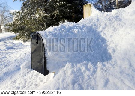 Mailbox covered in snow after a blizzard