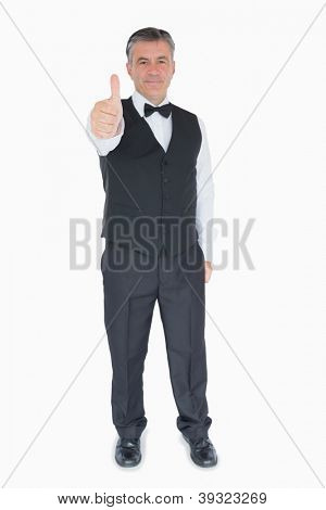 Smiling man showing thumbs up wearing a suit on white background
