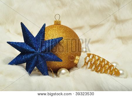 Christmas Decoration, Star, Cone And Ball On A White Fur Closeup