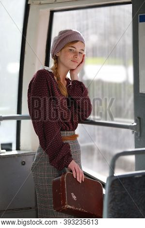 Young Lovely Freckled Girl In Retro Style Clothes Standing In A Wagon Of A Driving Tramway. Transpor