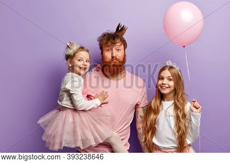 Happy Childhood And Celebration Concept. Redhead Family Of Father And Two Daughters Wear Crowns, Spe