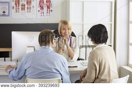 Couple At Reception Discussing Issues With A Sexologist