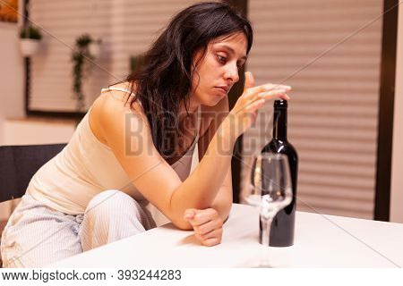 Addicted Woman Drinking Alone At Home. Unhappy Person Suffering Of Migraine, Depression, Disease And