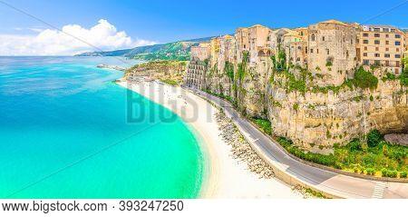Aerial Panoramic View Of Tropea Town And Beach Coastline Of Tyrrhenian Sea With Turquoise Azure Wate