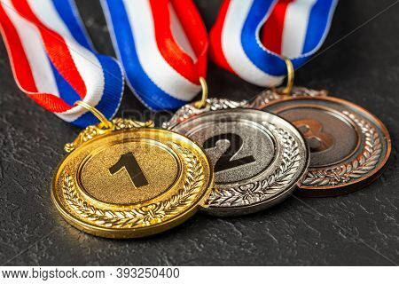 Gold, Silver And Bronze Medal With Ribbons. Award For First, Second And Third Place In The Competiti