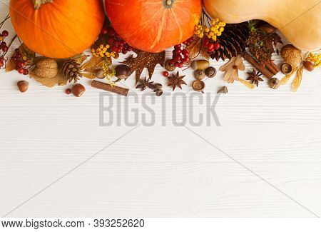 Autumn Flat Lay. Pumpkins, Anise, Cinnamon, Acorn, Nuts And Autumn Leaves On White Wood. Autumnal Se