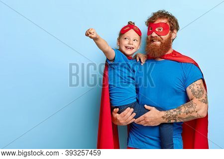 Happy Daughter And Father Have Supernatural Power, Little Girl Makes Flying Gesture, Wear Superhero