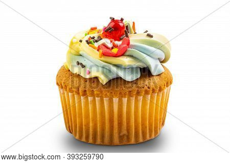 Vanilla Cup Cake Garnished With Butter Cream Frosting And Colorful Sprinkles Isolated On White Backg