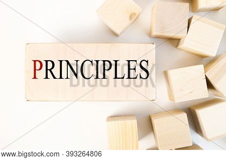 Principles, Text On A Block Of Wood Against A Light Background