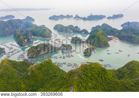 Aerial view of Floating fishing village in Lan Ha Bay, Vietnam. UNESCO World Heritage Site. Near Ha Long bay