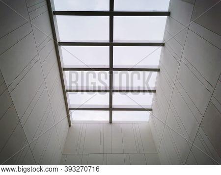 Modern Open Skylight (mansard Window) In An Attic Room Against Blue Skymodern Open Skylight (mansard