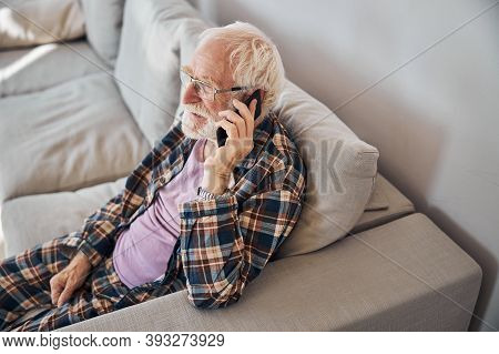 Male With Short Gray Hair Calling On The Cellphone