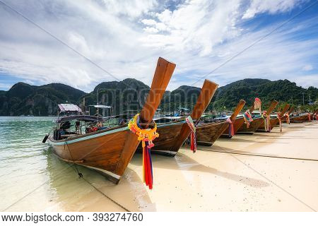 Traditional Thai Longtail Boat At Ton Sai Beach On Phi Phi Don Island, Thailand In A Summer Day
