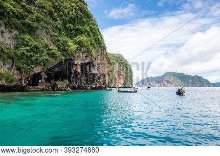 Landscape Of Viking Cave With Longtail Boat For Traveler, Maya Bay, Phi Phi Island, Andaman Sea, Kra