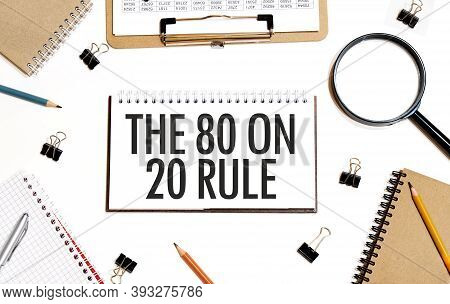 Business Concept. Notebook With Text The 80 On 20 Rule Sheet Of White Paper For Notes, Calculator, G