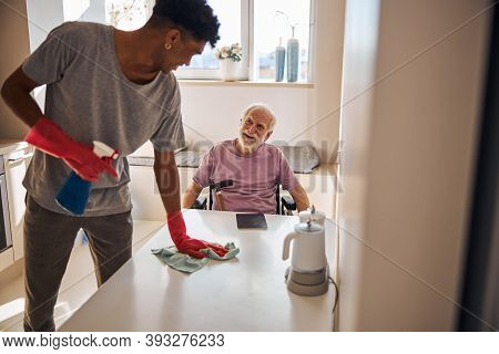 Young Man Doing The Cleaning In The Kitchen