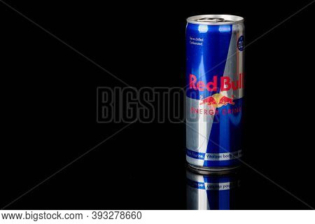 London, United Kingdom, 14th October 2020:- A Can Of Redbull Energy Drink Isolated On A Black Backgr