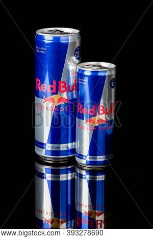 London, United Kingdom, 14th October 2020:- Cans Of Large And Small Red Bull Energy Drinks Isolated