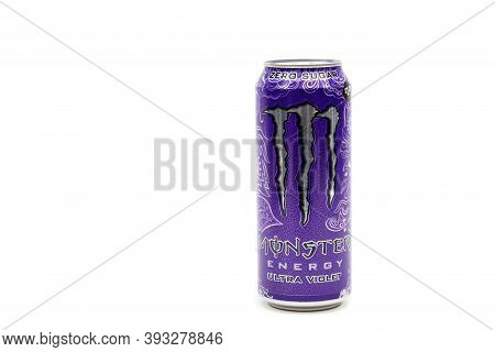 London, United Kingdom, 14th October 2020:- A Can Of Monster Ultra Violet Energy Drink Isolated On A