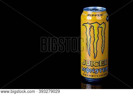London, United Kingdom, 14th October 2020:- A Can Of Monster Ripper Energy Drink Isolated On A Black