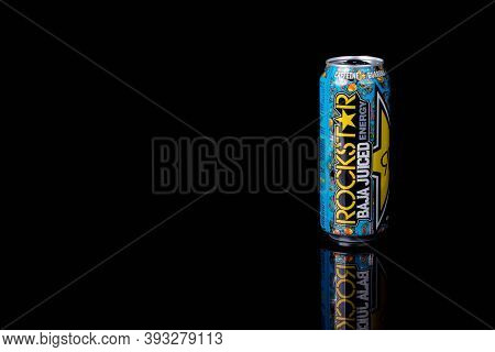 London, United Kingdom, 14th October 2020:- A Can Of Rockstar El Mango Energy Drink Isolated On A Bl