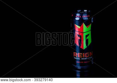 London, United Kingdom, 14th October 2020:- A Can Of Reign Melon Mania Energy Drink Isolated On A Bl