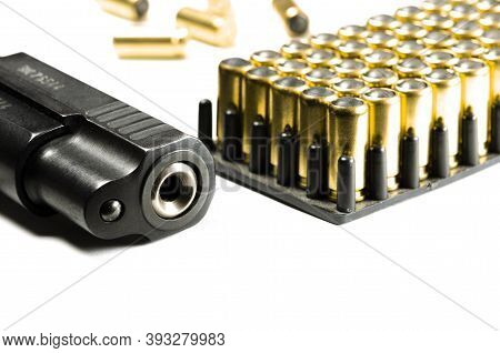 Legalization Of Weapons. The Legal Traumatic Short-barrel Weapon Lies On A White Background Next To