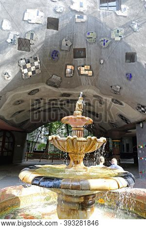 Vienna, Austria - July 12, 2015: Ceramic Fountain With Water By Famous Architect Hundertwasser In Wi