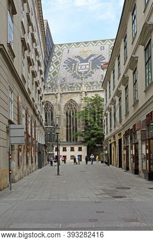 Vienna, Austria - July 12, 2015: Tourists Walking Around Saint Stephen Cathedral With Big Eagle At R