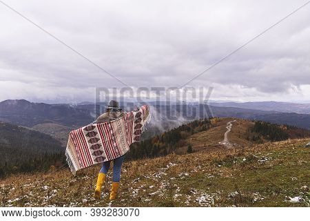 Wanderlust Concept. Woman In Boho Style In The Mountains