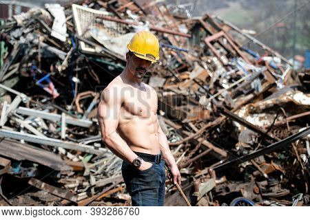 Man Showing His Body In Industrial Junk Yard