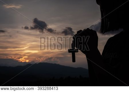 A Woman Holding A Crucifix Sunset Backdrop Christian Religious Concepts, Crucifixion Of Faith And Fa