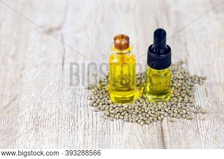 Cannabis Oil Products In Glass Bottles And The Cannabis Seeds Placed Together Fresh Cannabis Extract