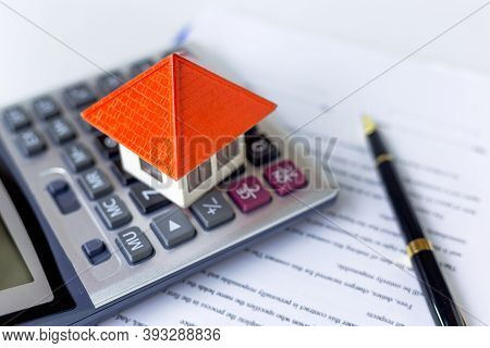 Orange Roof House On Calculator Business Investment Ideas, Economic Income, Safety, Financial Risk,
