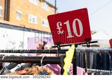 10 Sterling Pounds Red Price Sign On A Street Flea Market In London